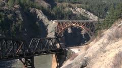 Cisco siding railroad bridges over Fraser River Stock Footage