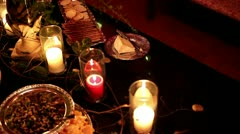 Placing meat tray on fancy dinner party table with candles Stock Footage