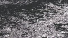 Fraser River, surface reflection back-lit, CU, somewhat surreal Stock Footage