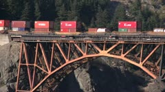 Railroad, bridge over Fraser River, container train long shot Stock Footage