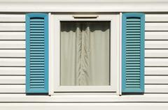 Stock Photo of window with wooden shutters
