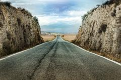 Stock Photo of old dramatic asphalt road