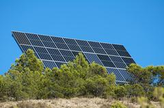 solar panels on the mountain - stock photo