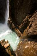 Stock Photo of Rainbow Over Pailon Del Diablo Waterfall In Ecuador