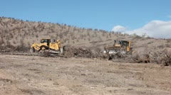 Bulldozer Caterpillar clear dead fire burned trees Stock Footage