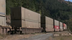Railroad, mountain siding container train medium shot Stock Footage