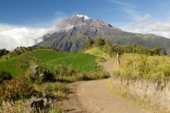 Road In The Highlands Of Andes Leading The Viewer To The Tungurahua Volcano - stock photo