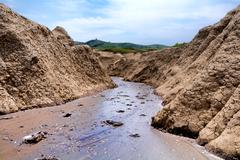 Stock Photo of The Berca Mud Volcanoes Are A Geological And Botanical Reservation Located In
