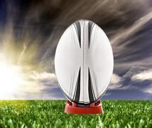 rugby ball ready to be kicked on the field - stock photo