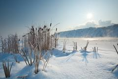 Sun Rising From The Clouds In Very Cold Winter Morning - stock photo
