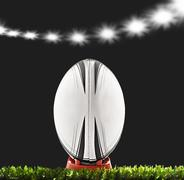 a rugby ball on a rugby field - stock photo