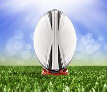 rugby ball ready to be kicked over the goal posts - stock photo