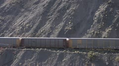 Freight train on canyon wall auto carriers Stock Footage