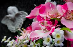 flowers and angel - stock photo