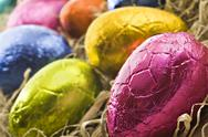 Stock Photo of colorful easter eggs in straw