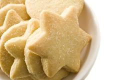 Star shaped homemade cookies in a white plate Stock Photos