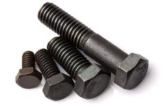 Set Of Four Different Sizes Of Screws Studio Isolated Shot Stock Photos