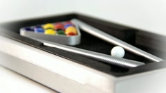 Miniature pool table with balls and sticks on white background Stock Footage