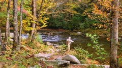 Elderly fly fisherman autumn Stock Footage