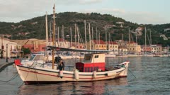 Fishing boat moored at gaios harbour paxos, greece Stock Footage