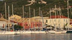 Yachts or sail boats moored at gaios, paxos, greece Stock Footage