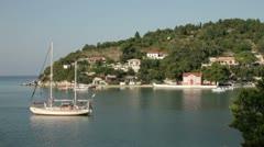 Sail boat anchored in idyllic lakka bay, paxos, greece Stock Footage