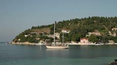 Yacht anchored in idyllic lakka bay, paxos, greece Stock Footage