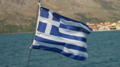 Panned shot of greek flag waving in the wind on yacht in the ionian sea Stock Footage
