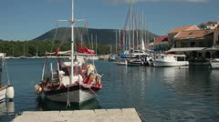 Red and white fishing boat moored at fiscardo, kefalonia, greece Stock Footage