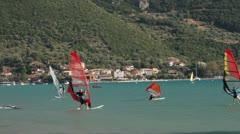 Windsurfers catch the wind in vassiliki bay, lefkas island, greece Stock Footage