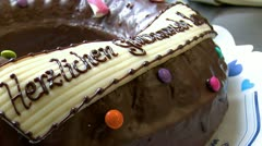 German bakery dolly around birthday cake close Stock Footage