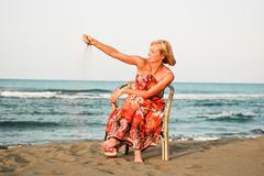 solitude woman on the beach - stock photo