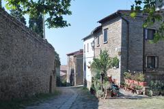 Little Italian street in Cortona. - stock photo