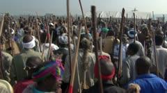 Large group of Zulu men walking in traditional gear. Stock Footage