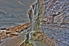 waterfall dorset kimmeridge bay - stock photo