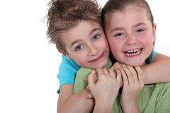 Little boy and little girl hugging Stock Photos