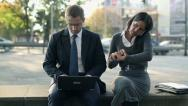 Stock Video Footage of Business people with laptop and cellphone in the city, steadicam shot HD