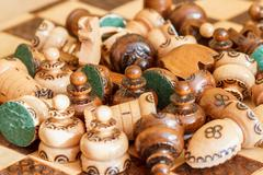 abandoned wooden pieces of chess - stock photo