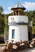 lighthouse for childs play in park - stock photo