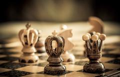 Chess with focus to black king in front Stock Photos