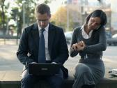 Business people with laptop and cellphone in the city, steadicam shot NTSC Stock Footage