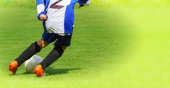 soccer player legs dribbling in a match - stock photo