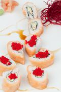 Sake Kani Sushi Rolls On A White Plate Studio Shot - stock photo