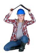 Tradeswoman covering her head Stock Photos