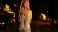 Blonde girl walking Stock Footage