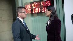 Business couple talking about financial market, steadicam shot HD Stock Footage