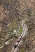 Touristic Train Passing By Alausi City In Ecuadorian Andes Stock Photos