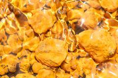 Yellow Iron Oxide Sediments On Rocks Near Tungurahua Volcano Ecuador South - stock photo
