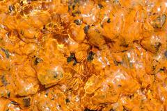 Orange Iron Oxide Sediments On Rocks Near Tungurahua Volcano Ecuador South - stock photo