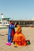 16. jul 2012 - couple preparing for posing to tourists in venice, italy Stock Photos